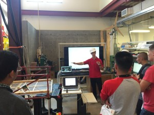Jose explaining the importance of Structural Health Monitoring to students